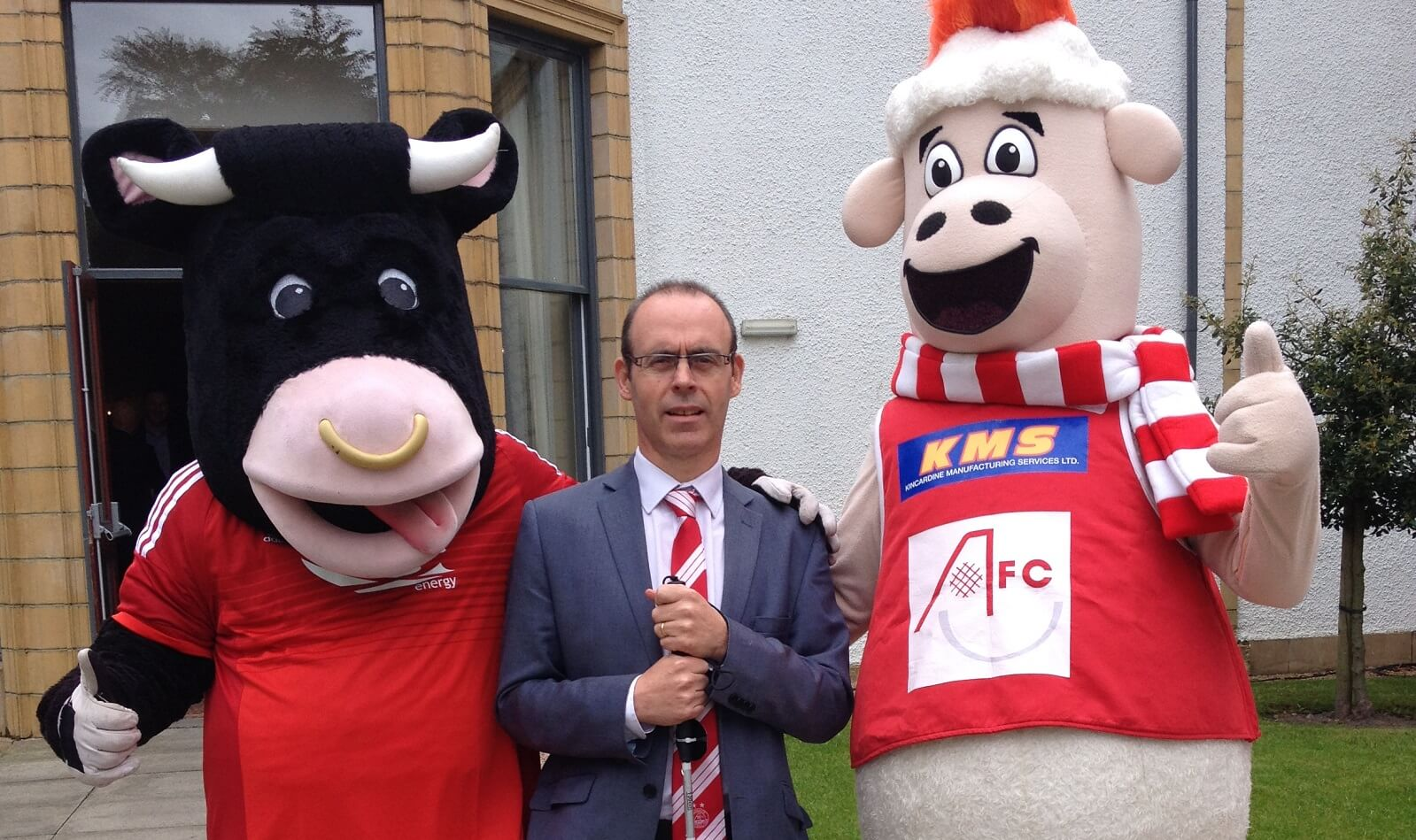 Aberdeen FC mascots, Angus the Bull and Donny the Sheep with Graham Findlay, Chief Executive of NESS