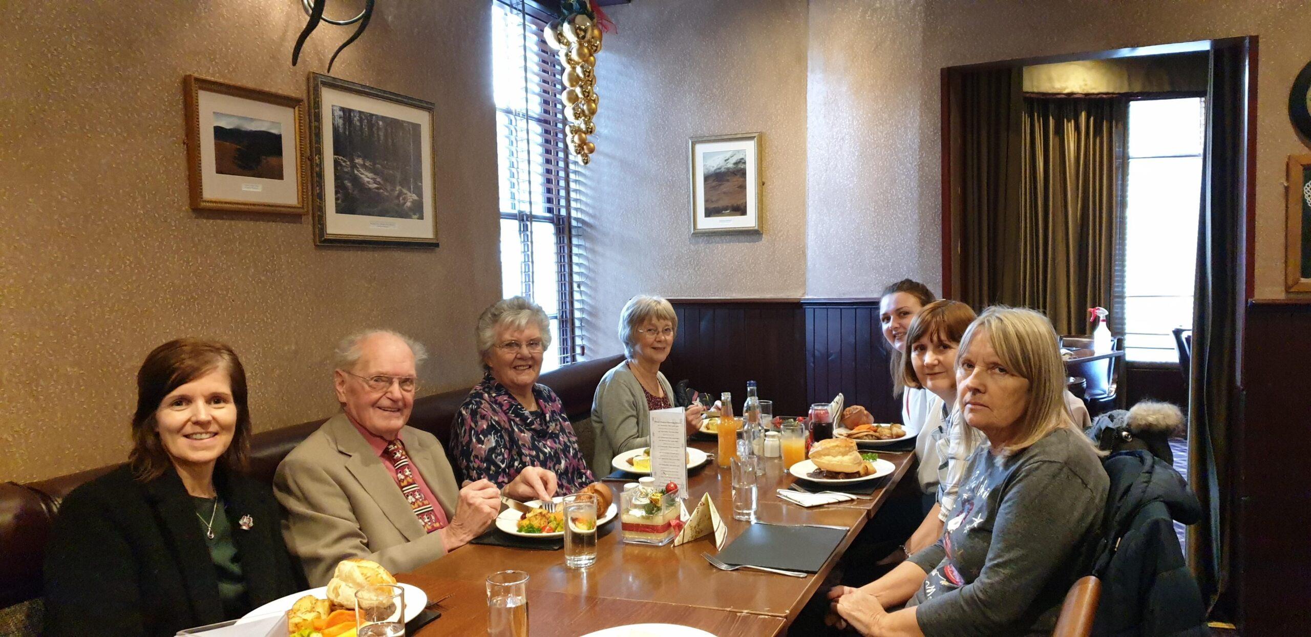 People enjoying a festive Xmas lunch