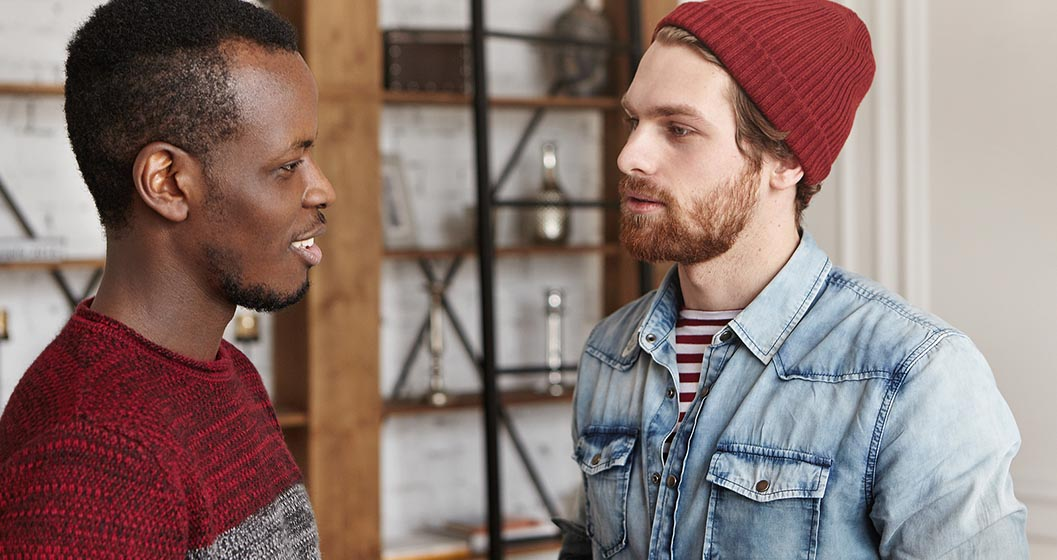 Two young men in conversation