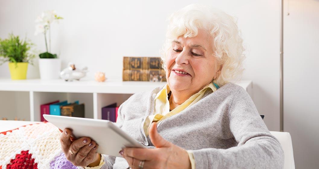 Elderly woman viewing her iPad