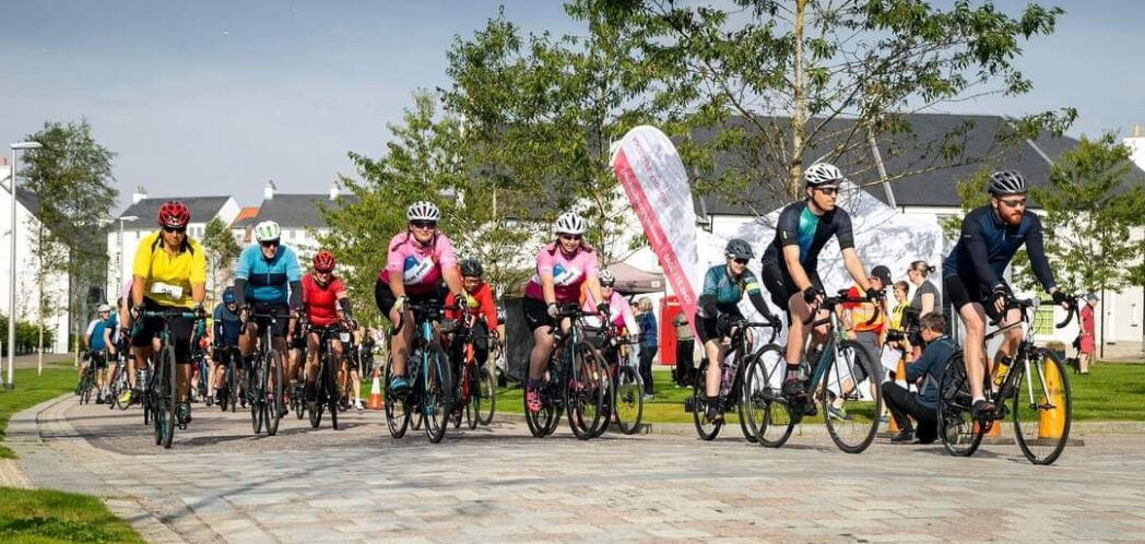 Group of cyclists in cycling gear get ready to start the Chapelton race